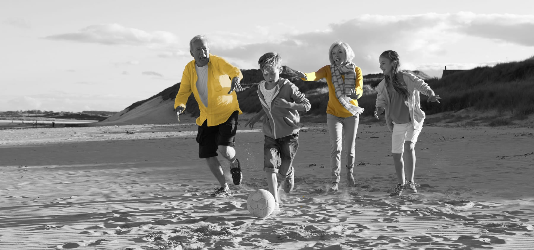 healthy family running the beach promoting physiotherapy clinic