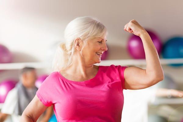 senior woman flexing muscle