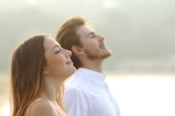 couple breathing peacefully advertising a health seminar