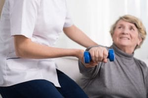 woman lifting weights in therapy