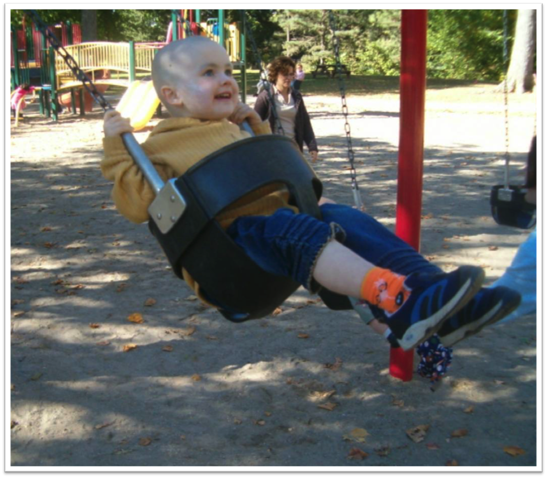child on swing set